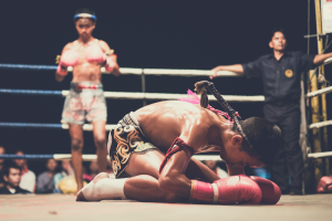 muay thai fighters in a ring prepping